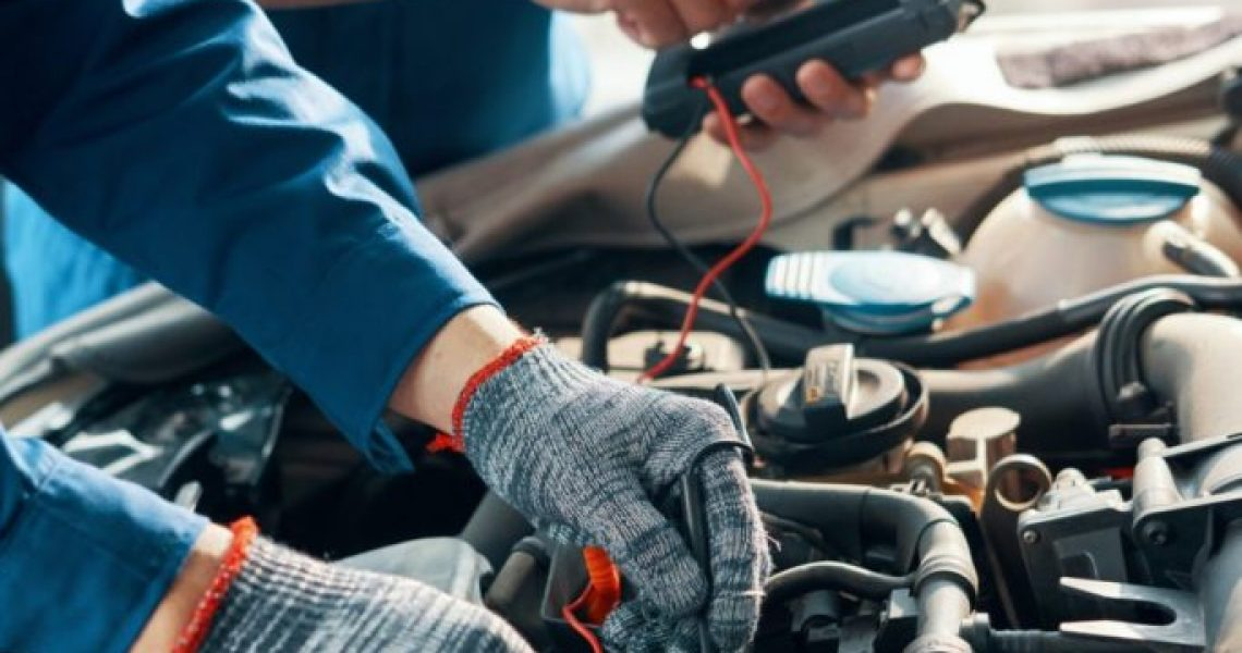 mechanics-testing-car-motor-684x1024